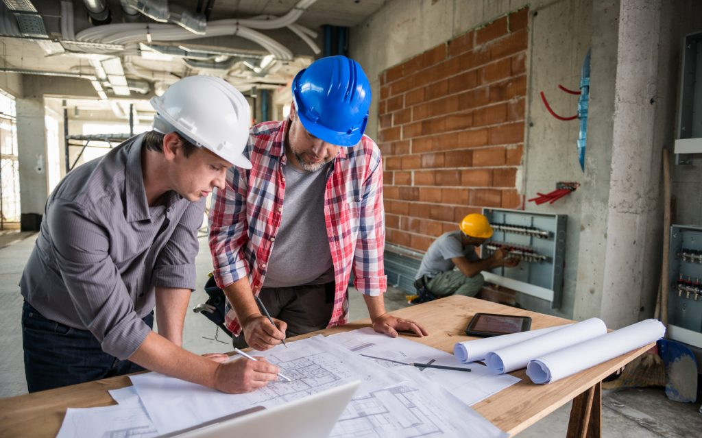 Looking for an apprenticeship devon and cornwall training provider architect and construction worker reviewing blueprint together malvernweather Choice Image