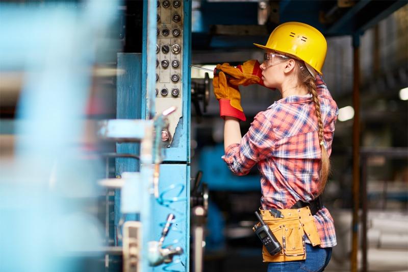 woman machinery repair